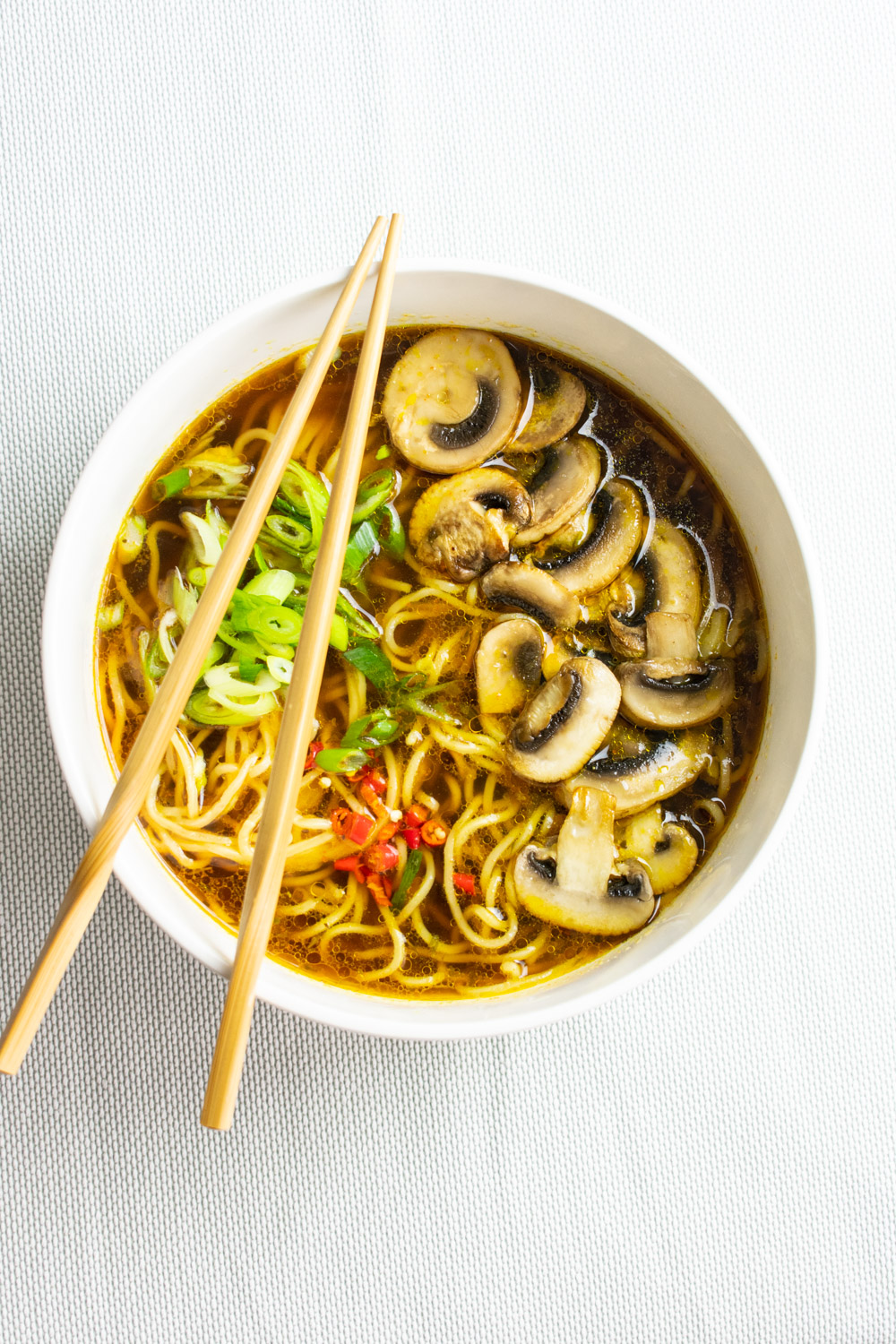 Mushroom noodle soup cooked in vegetable broth. This is an easy ramen recipe that is perfect for a winter evening.